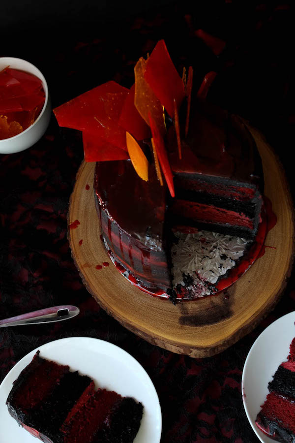 Fire and Blood Dragon Cake with Red Velvet and Chocolate cake layers, strawberry-raspberry sauce filling, red velvet and black chocolate buttercream and candy fire shards!