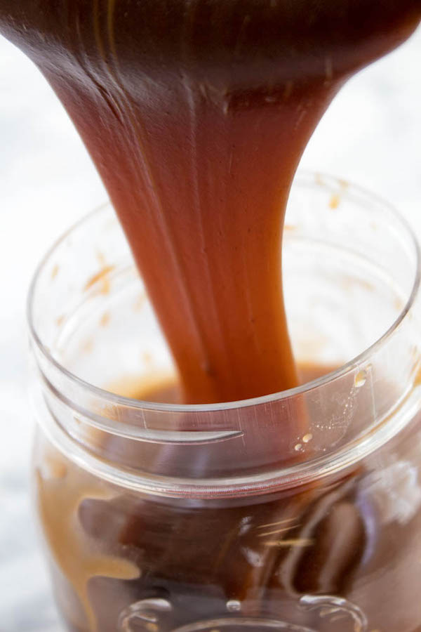 This salty and sweet Homemade Salted Caramel Sauce is perfect for any type of dessert, including cakes, cupcakes, cheesecakes, ice cream and so much more!
