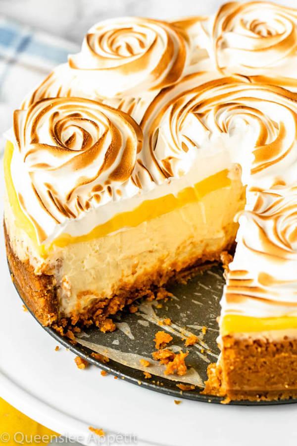 lemon meringue cheesecake with graham cracker crust, lemon cheesecake, lemon curd topping, meringue rosettes
