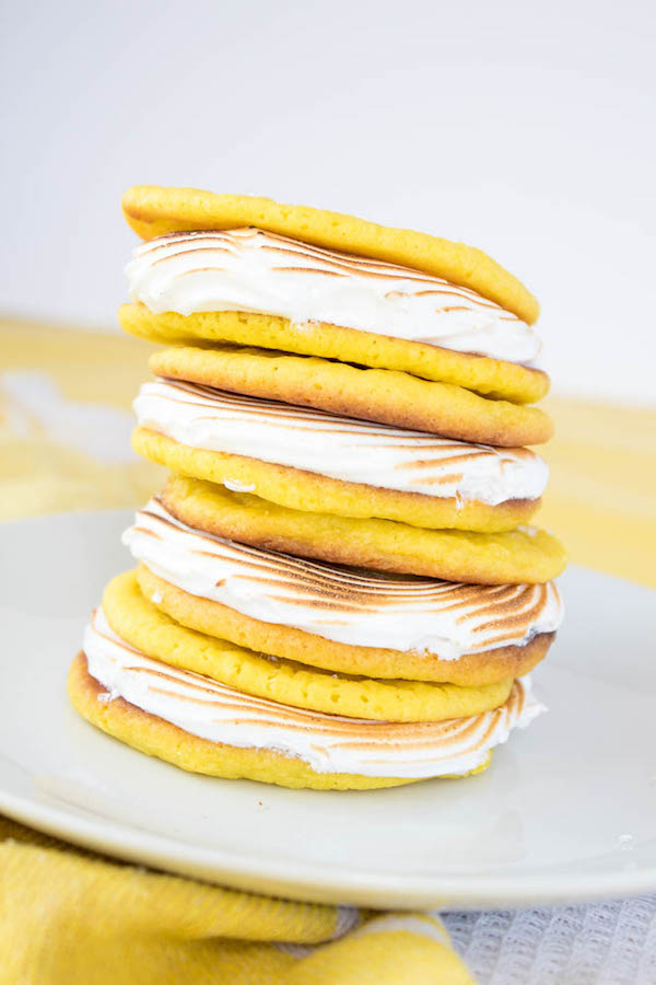 Soft and chewy lemon sugar cookies filled with fluffy meringue and delicious lemon curd!