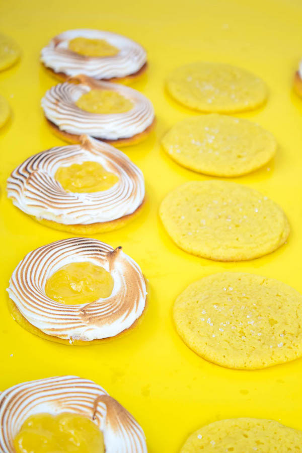 These Lemon Meringue Sugar Cookie Sandwiches are made with a soft and chewy lemon sugar cookie and a ring of toasted meringue that is filled with creamy lemon curd. The perfect dessert for Summer!