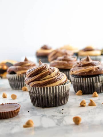 These Chocolate and Peanut Butter Lava Cupcakes are the perfect dessert for every chocolate/peanut butter lover. Rich dark chocolate cupcakes stuffed with Reese's cups and filled with a molten peanut butter lava filling. Top it off with a chocolate and peanut butter swirl frosting and another Reese's peanut butter cup!