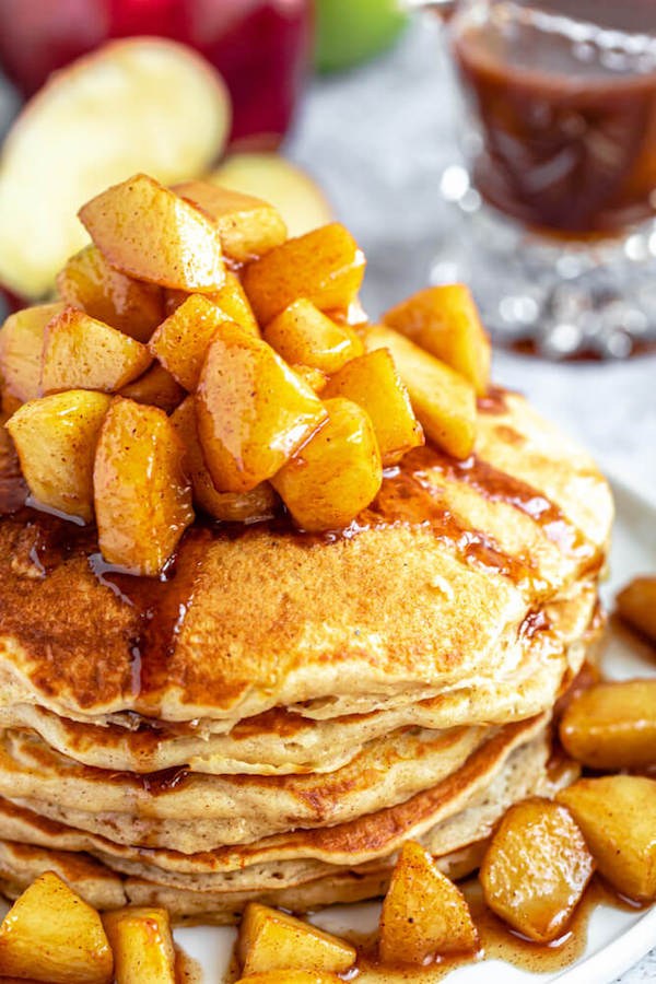 apple cinnamon pancakes topped with maple cinnamon apple topping