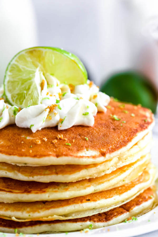 lime pancakes with whipped cream, graham cracker crumbs, lime zest and a lime twist on top