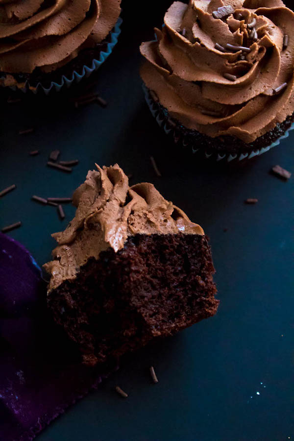 These Chocolate Cupcakes are perfectly moist, fluffy and full of rich chocolate flavour! Topped with a silky and dreamy Chocolate Buttercream Frosting - these cupcakes are the perfect treat for chocoholics.