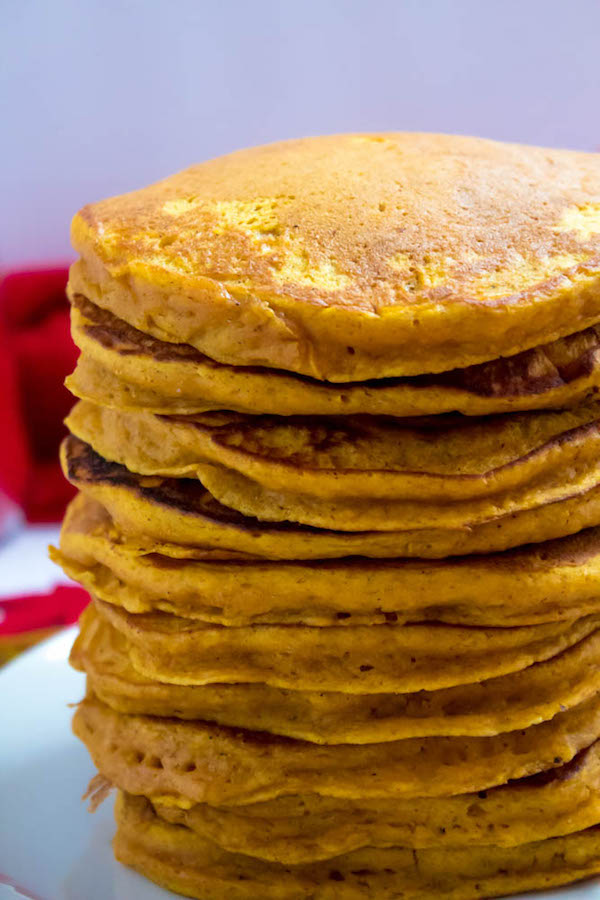 These Pumpkin Pancakes are light, fluffy and has the perfect amount of pumpkin and spice flavour! Topped with a rich and delicious Maple Pecan Praline Syrup, these irresistible pancakes are the perfect fall breakfast!