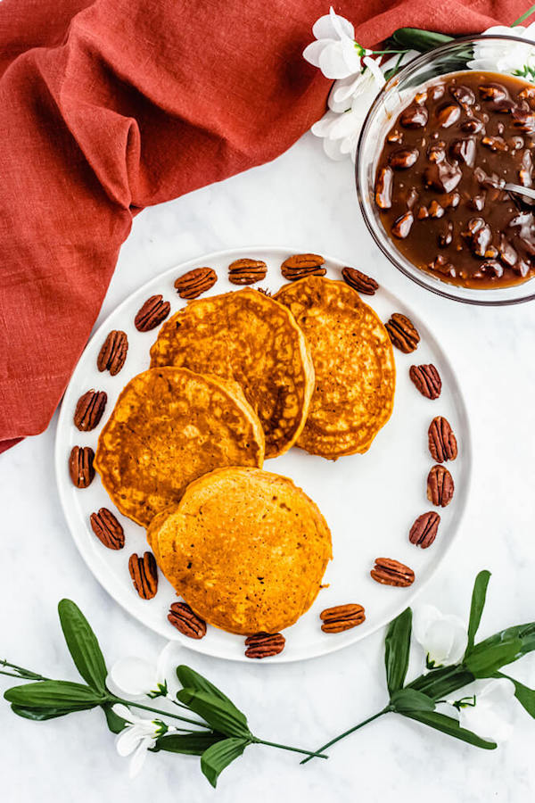 pumpkin pancakes surrounded by pecans