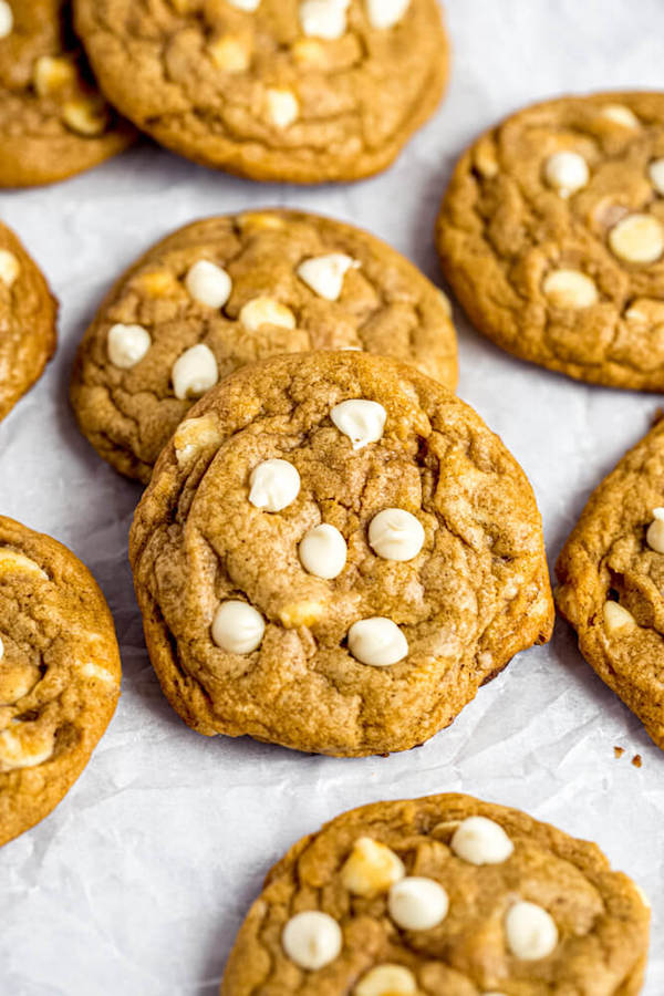 white chocolate chip pumpkin cookies on parchment paper