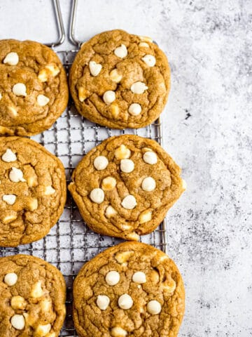 white chocolate chip pumpkin cookies on a safety grater