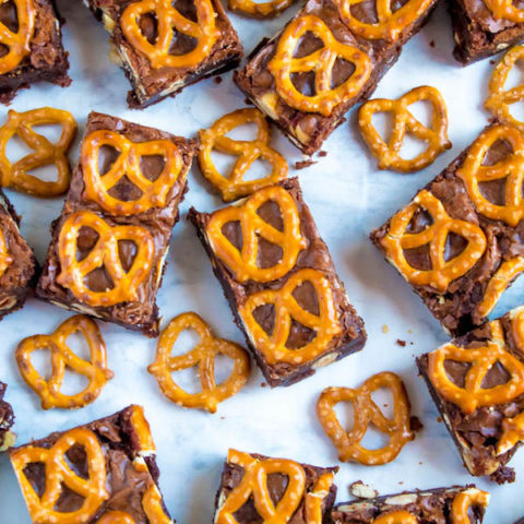 Salty meets sweet in these Nutella Pretzel Brownies! A perfectly fudgy Nutella brownie with roasted hazelnuts and salty pretzels mixed in. This decadent dessert will satisfy all of your salty and sweet cravings!
