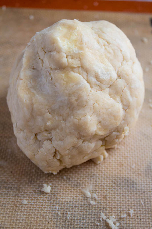 shaping pie dough into a ball