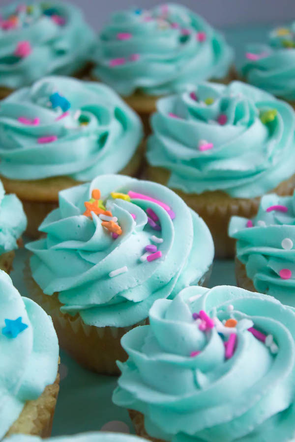 These Vanilla Cupcakes are light, fluffy and incredibly moist! Topped with a creamy and Dreamy Vanilla Buttercream, these are the best cupcakes for a birthday party or any event!