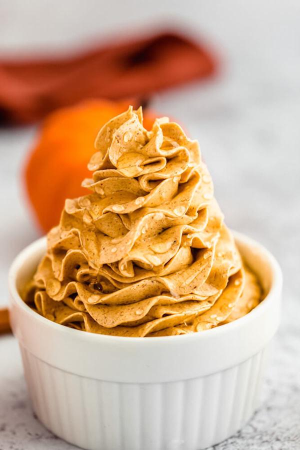 swirl of whipped pumpkin spice honey butter in a ramekin