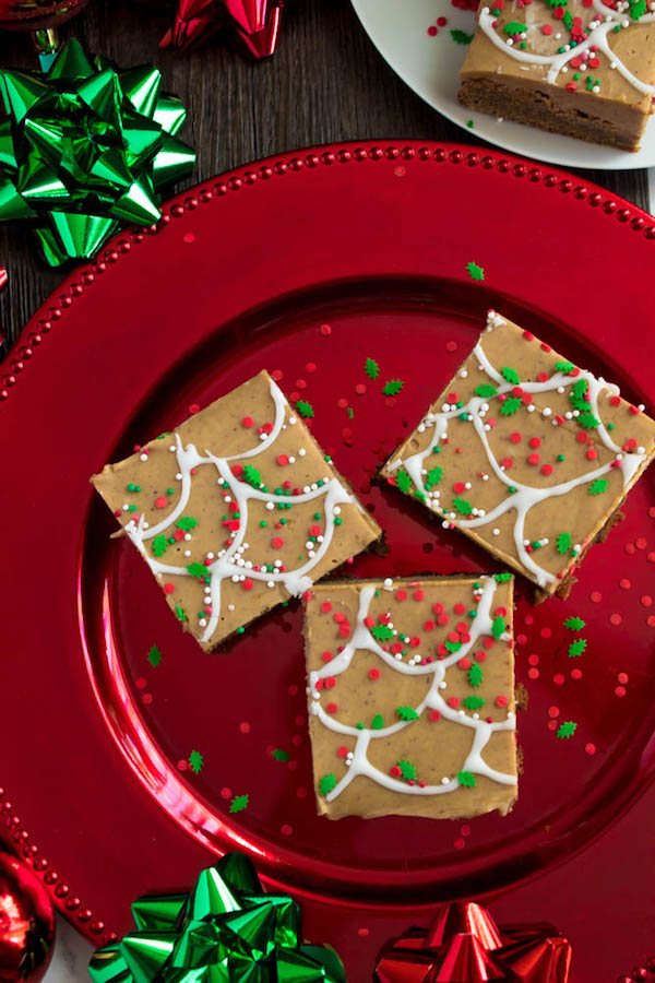 These Gingerbread Fudge Blondies are an amazing twist to the classic holiday cookie. They consist of a chewy, perfectly spiced gingerbread blondie topped with a melt-in-your-mouth gingerbread fudge! These festive bars make the perfect holiday treat!