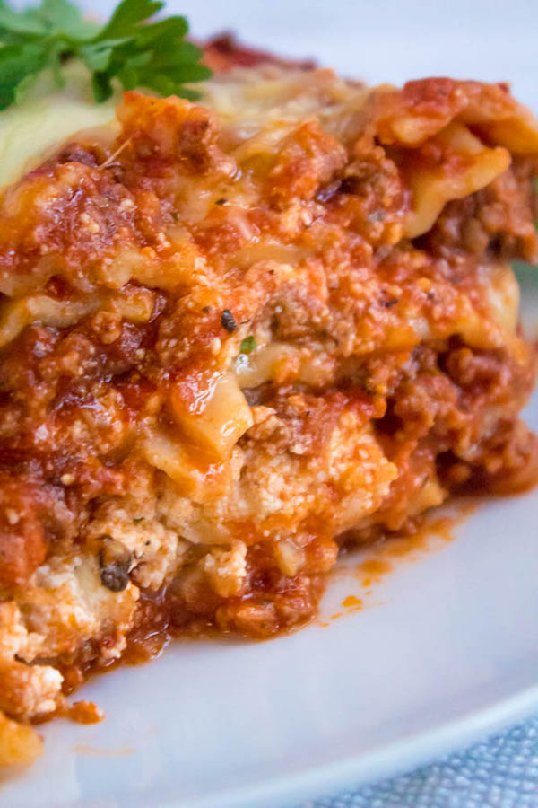 This Lasagna is the best I've ever had! Layers of a thick and meaty sauce, creamy ricotta filling and a cheesy topping. I guarantee this will be your new favourite go-to recipe for the holidays!