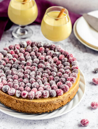 eggnog cheesecake covered with sugared cranberries
