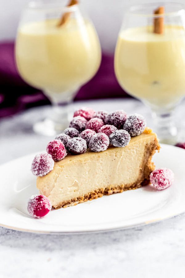 slice of eggnog cheesecake with sugared cranberries on top