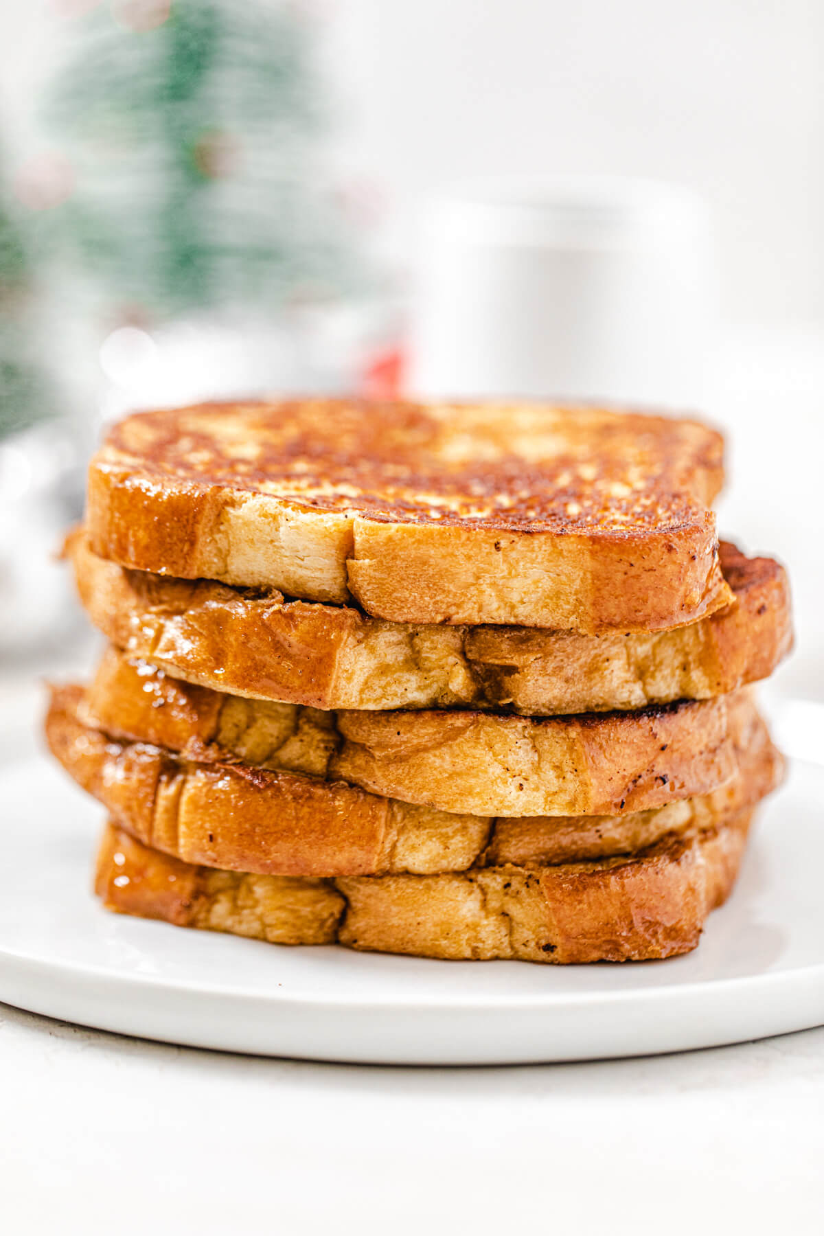 stack of French toast on a white plate