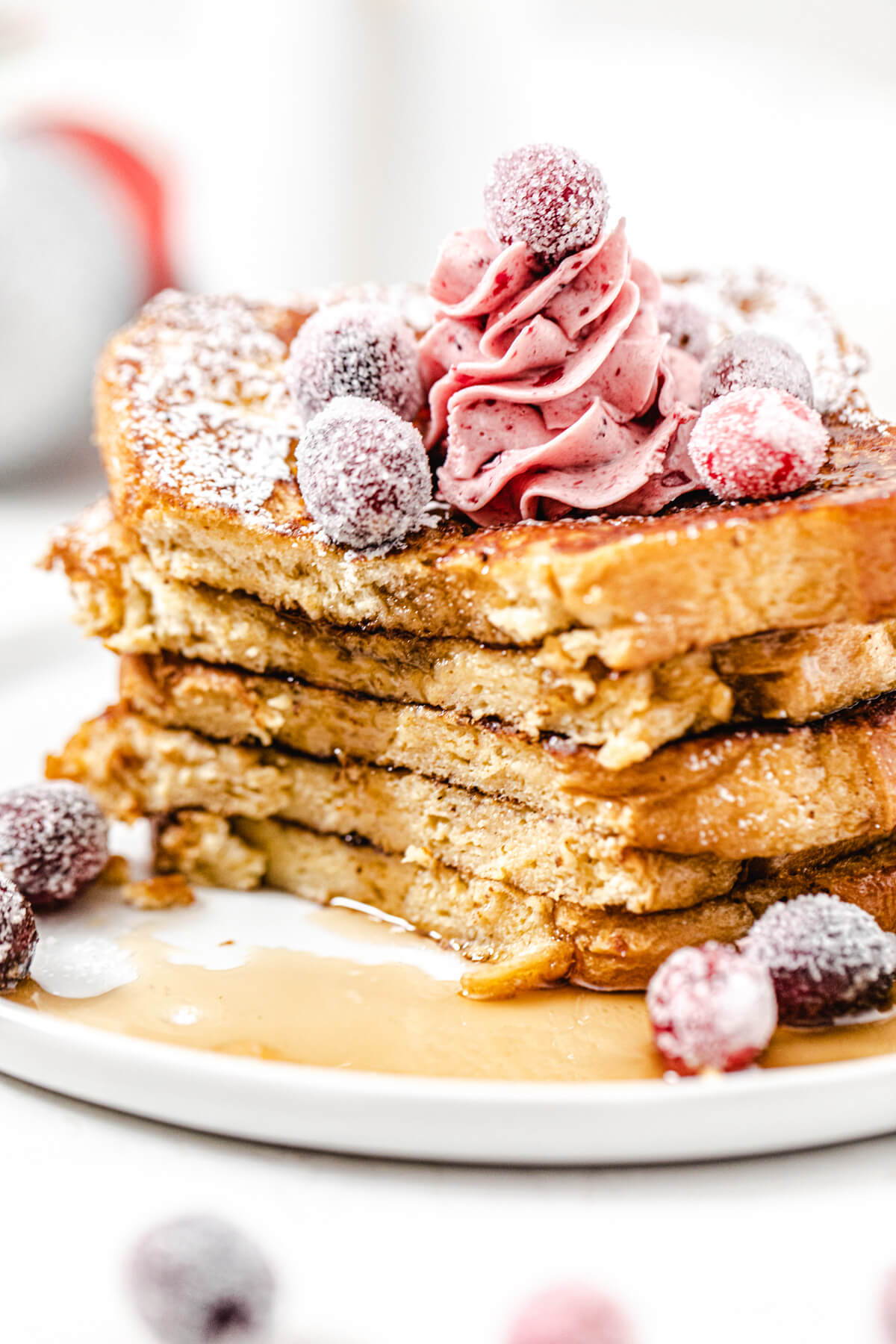 close up of a stack of sliced French toast on a plate