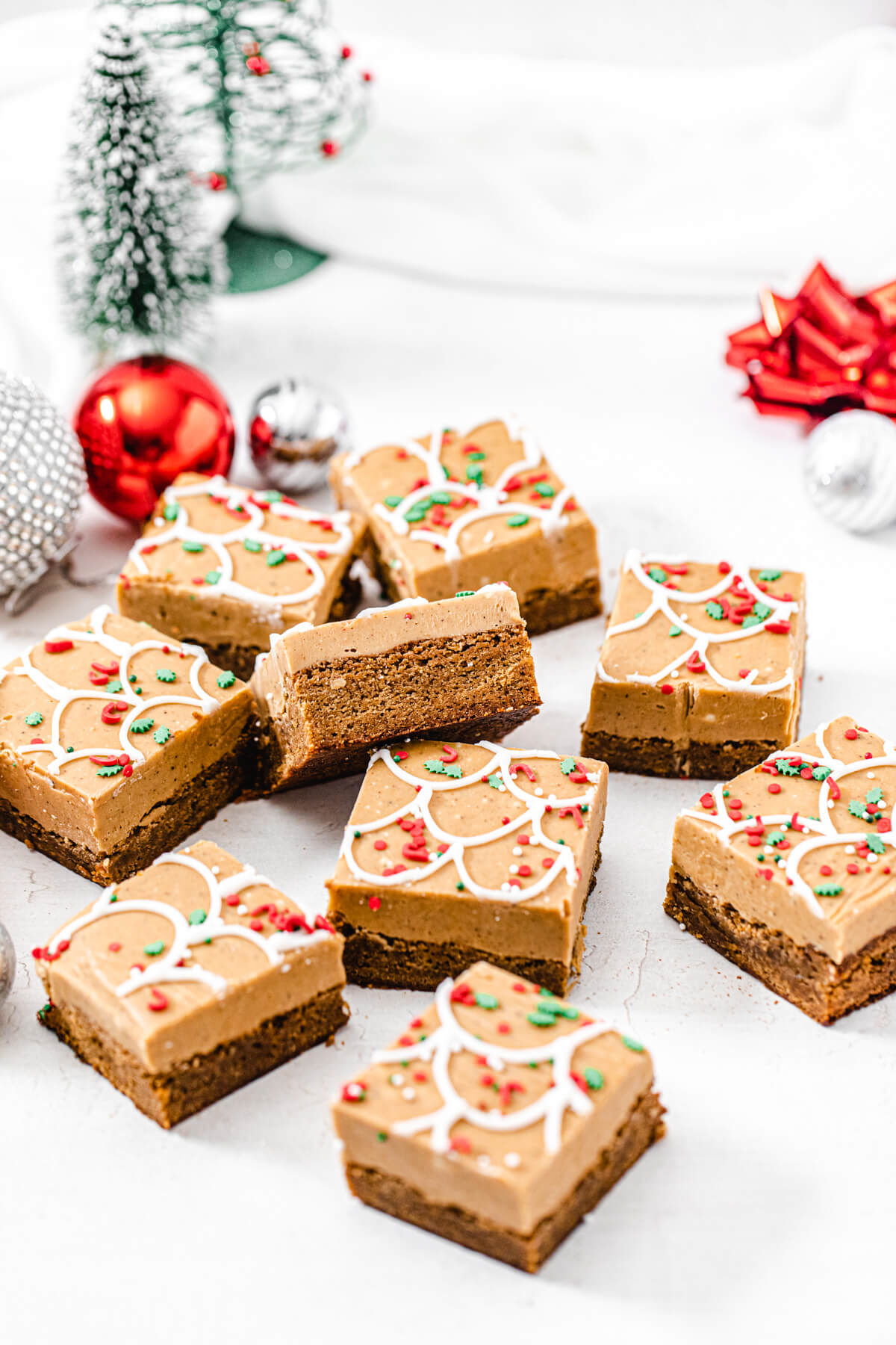 pile of gingerbread blondies with ornaments and Christmas trees in the background