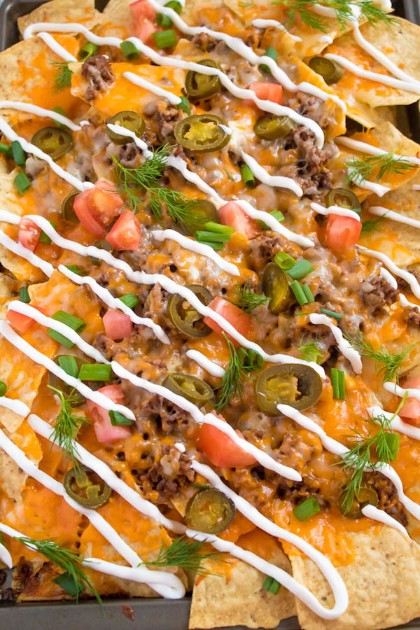 These tasty Nachos are loaded with taco-seasoned ground beef, jalapeños, 2 different cheeses and so much more! Serve them at your Superbowl party, movie night, or any occasion!