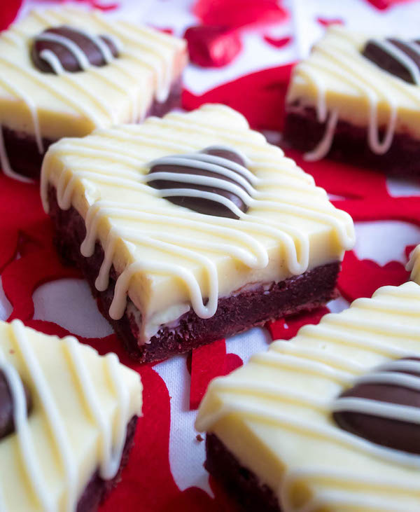 These White Chocolate Fudge Red Velvet Brownies are an upgrade from the classic cake. Rich, fudgy and decadent red velvet brownies, topped with a chewy white chocolate fudge and a drizzle of cream cheese icing for the perfect finishing touch!