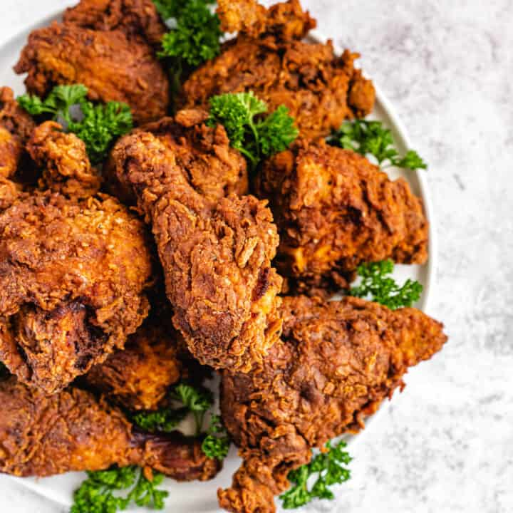 top view of fried chicken and parsley on a platter