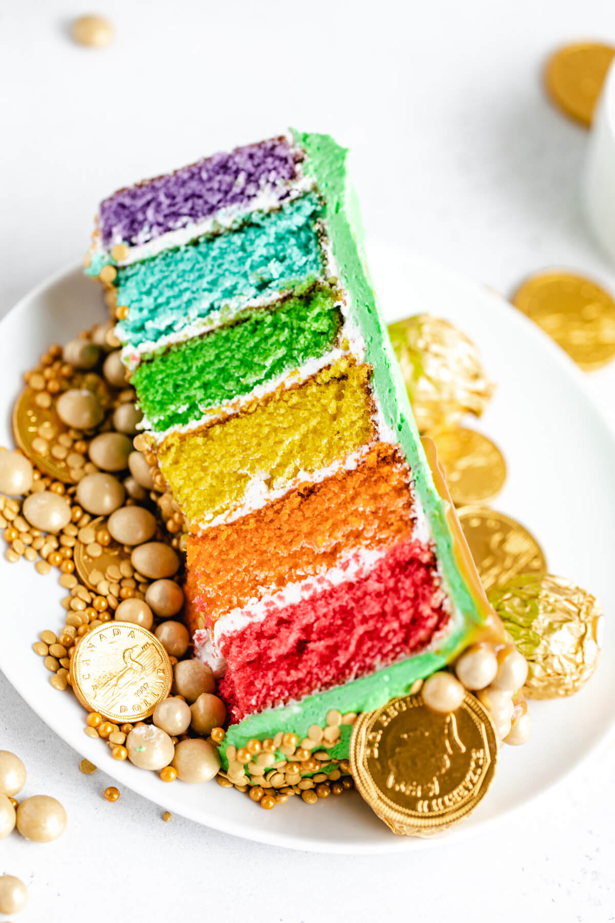 slice of rainbow cake on a white plate
