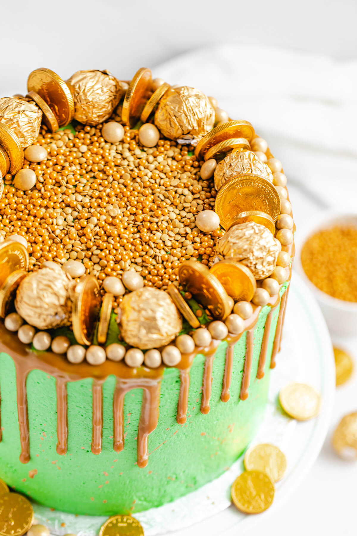 close up of cake with gold sprinkles on top
