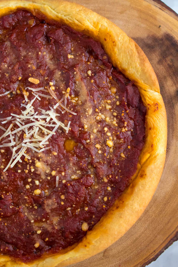 This Chicago Deep Dish Pizza is without a doubt, the best in the world! With it's flaky, buttery deep dish crust, layers of ooey gooey cheeses and customizable toppings, and a thick layer of the most flavourful tomato sauce — no other pizza compares!