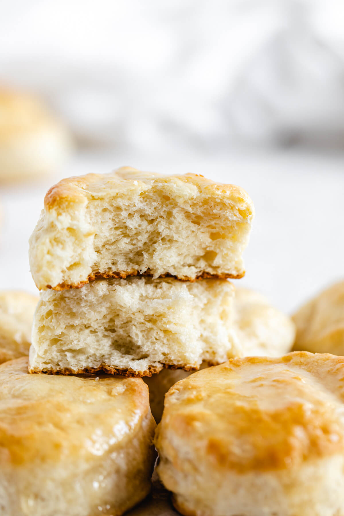 halved biscuits on top of whole biscuits