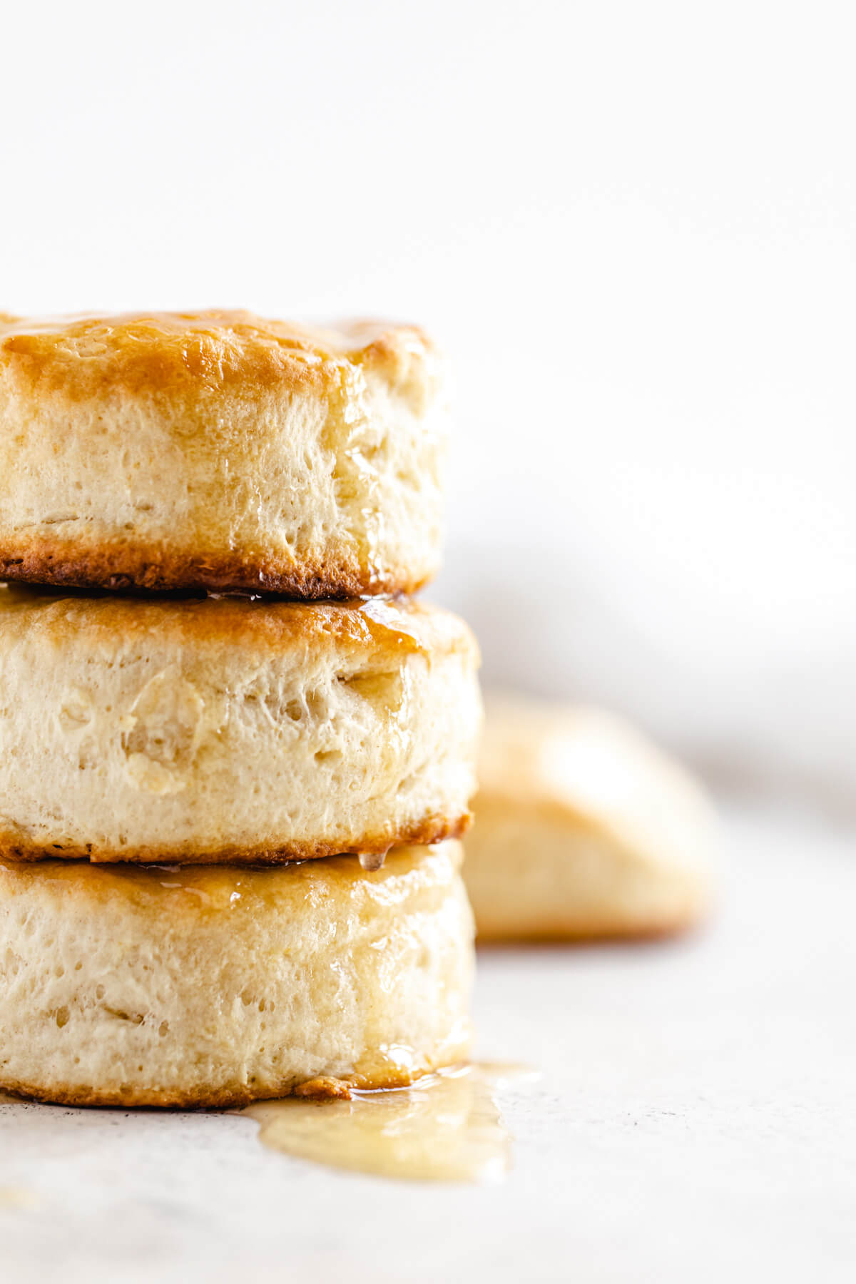 close up showing half of a stack of three biscuits