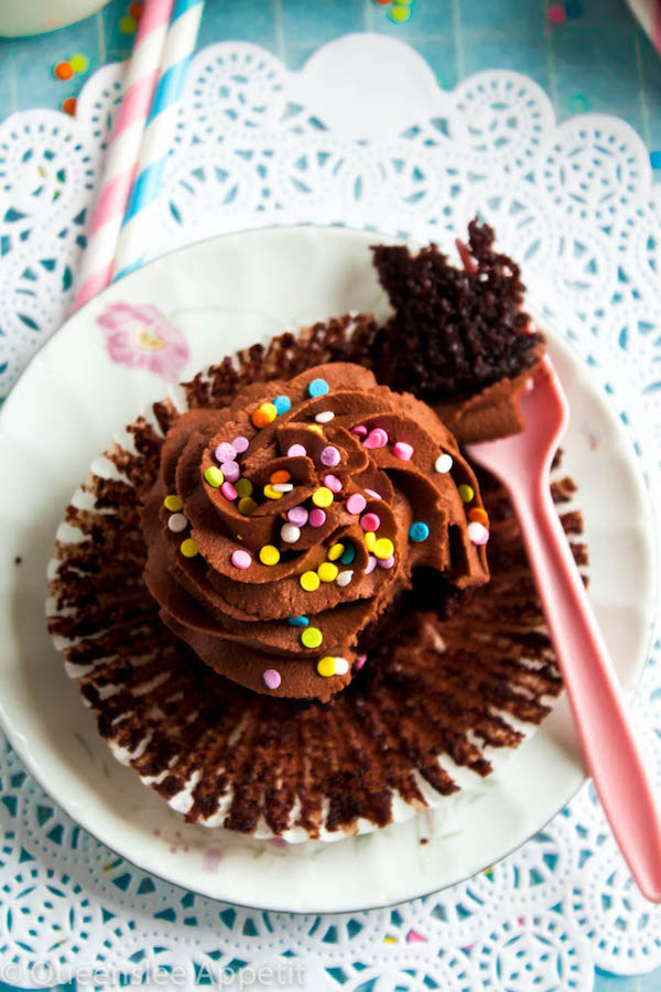 These Vegan Chocolate Cupcakes are super moist and full of chocolate flavour! Topped with a luxuriously rich Vegan Chocolate Buttercream, you'd never guess that these cupcakes are 100% dairy and egg-free!