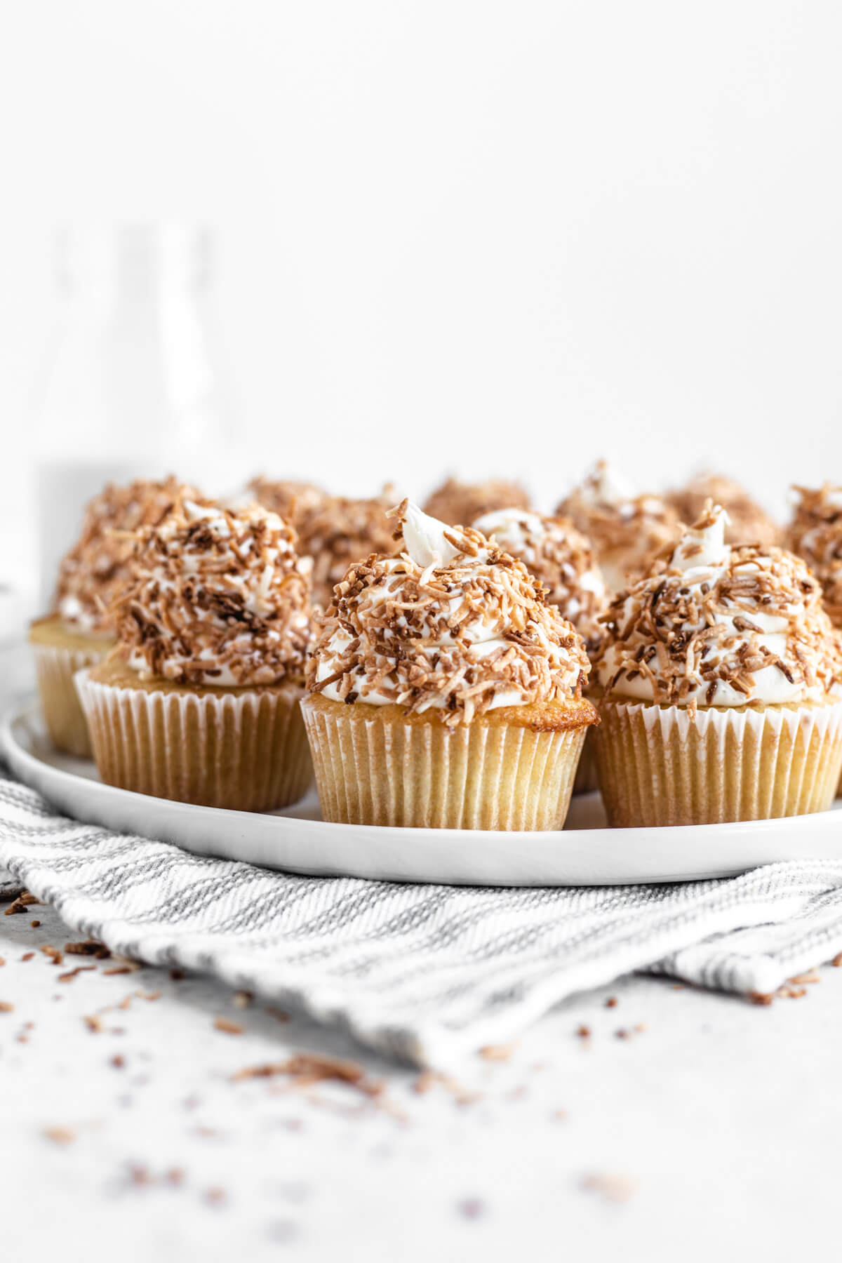 coconut flavoured cupcakes on a white plate