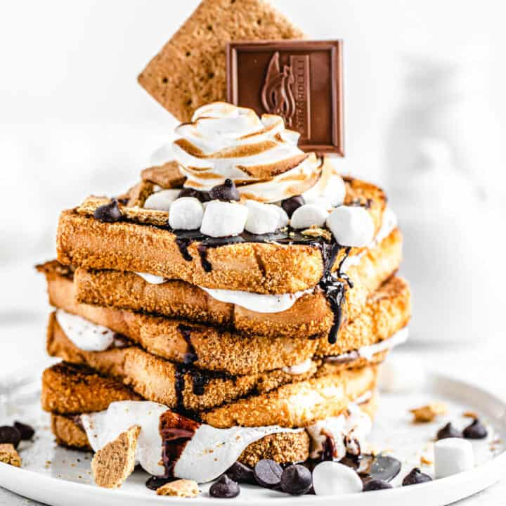 stack of marshmallow filled graham cracker French toast topped with chocolate, marshmallows and graham crackers