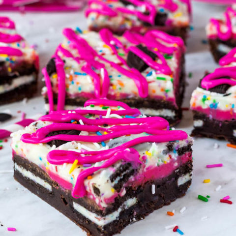 These Birthday Cake Oreo Fudge Brownies are super rich and decadent. Layers of fudgy Birthday Cake Oreo stuffed brownies and Funfetti fudge are topped with more Oreos and plenty of sprinkles. Drizzle these bars with hot pink candy melts and you've got a party in a brownie!