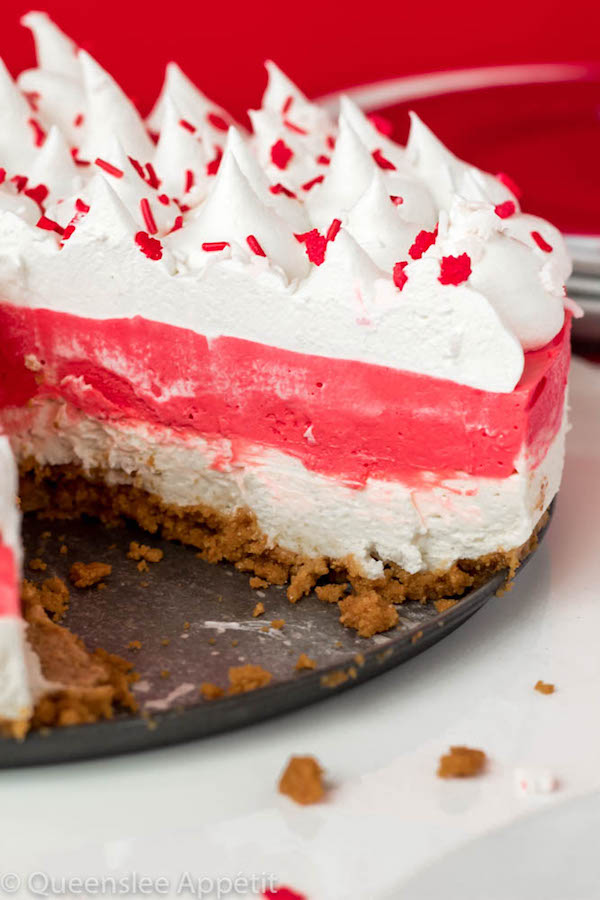 This No-Bake Canada Day Cheesecake is an unbelievably easy dessert that takes absolutely no time or effort to make! The red and white layers, cool whip topping and red and white sprinkles makes this the perfect dessert for Canada Day!