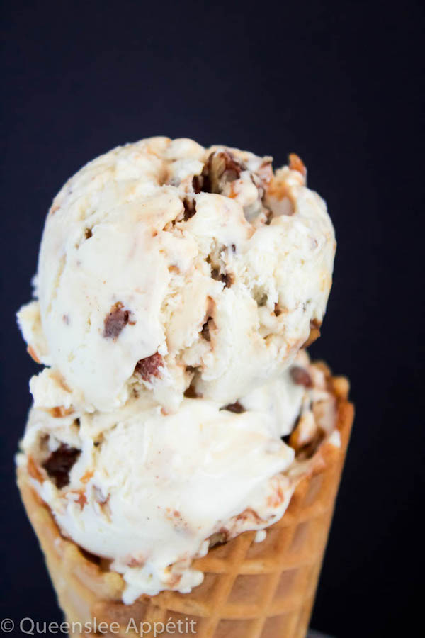 This No-Churn Candied Pecan Caramel Swirl Ice Cream starts with a simple creamy vanilla ice cream. Mix in chunks of crunchy, sweet candied pecan pieces and swirl in a ribbon of silky homemade caramel sauce for a super easy summer treat!