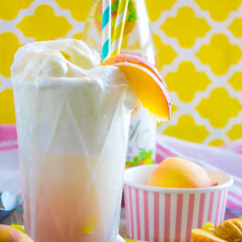 These Peaches and Cream Floats are a super delicious and refreshing drink. Scoops of creamy vanilla ice cream topped with a sparkling peach beverage and club soda. This fizzy drink is perfect for a hot summer day!