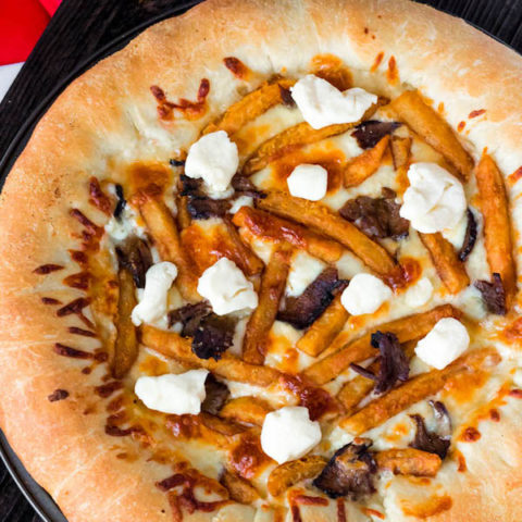 This classic Canadian dish just got better! This Poutine Pizza is topped with poutine gravy, shredded mozzarella and white cheddar cheese, crispy fries, steak and chunks of white cheddar cheese curds! To take it to the next level, the crust is stuffed with cheese!