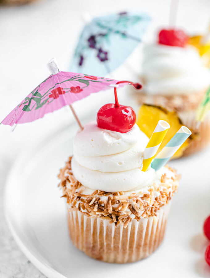 close up of cupcake on a white plate
