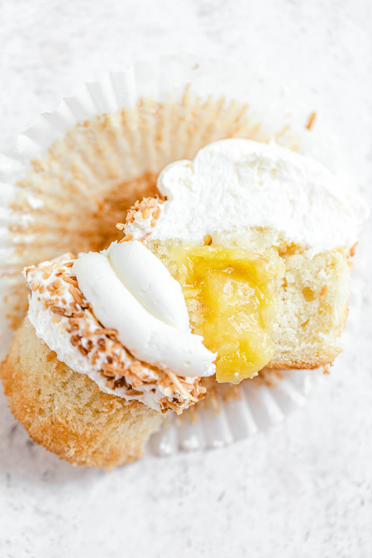 halved cupcake with pineapple filling inside