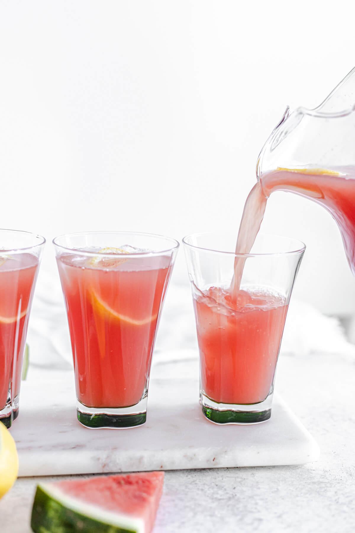pouring lemonade into glass