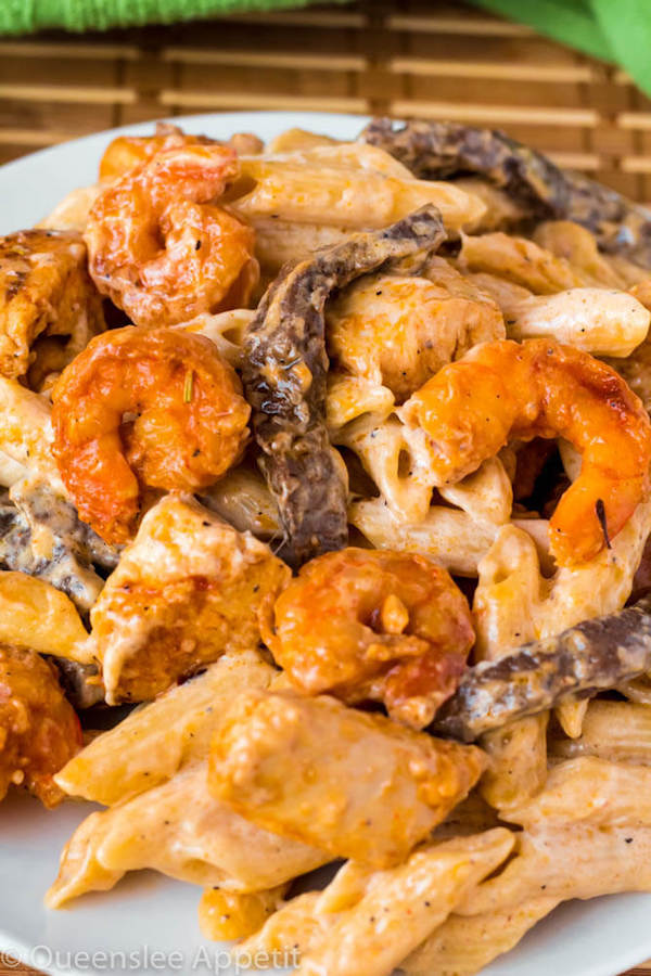 This Cajun Shrimp Chicken and Steak Alfredo Pasta is made with penne pasta, cajun flavoured shrimp, chicken and steak all coated in a creamy Alfredo sauce. An easy weekday dinner jam-packed with loads of flavour in every bite!