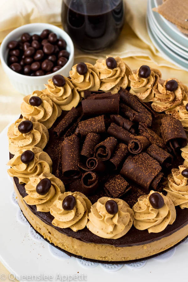 This Coffee Brownie Cheesecake consists of a creamy coffee cheesecake sitting on top of a dense brownie bottom, topped with a rich coffee chocolate ganache, chocolate curls, coffee whipped cream and chocolate covered coffee beans.