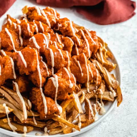 large plate of buffalo chicken nuggets and fries
