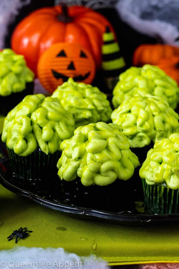 These Zombie Brain Cupcakes are a fun and spook-tacular treat for Halloween. Black Velvet cupcakes are filled with green zombie goo and topped with a delicious buttercream zombie brain!