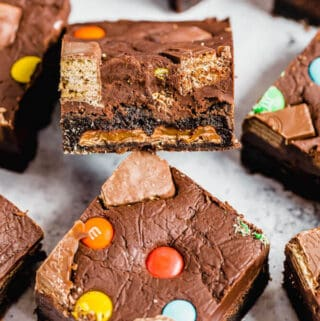 brownies topped with fudge and stuffed with halloween candy