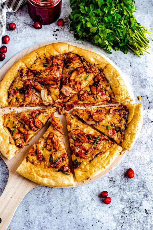 cranberry bbq turkey pizza cut into slices