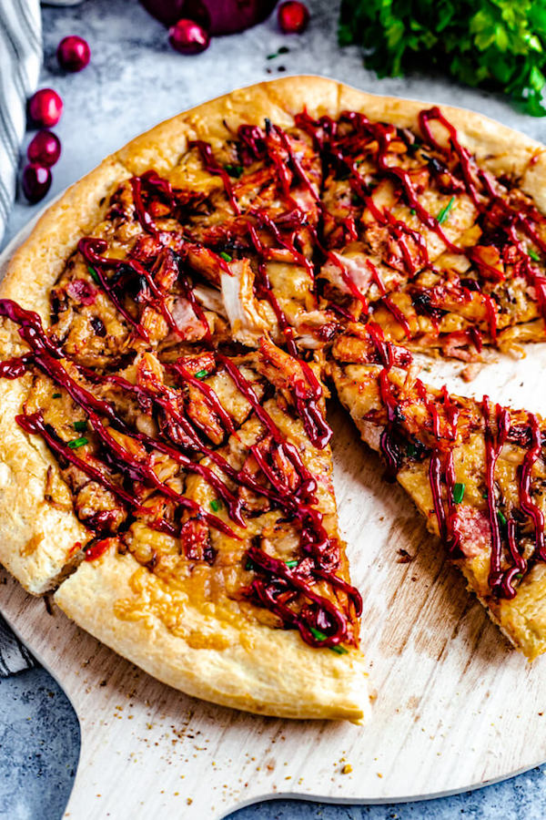 sliced pizza with a drizzle of cranberry bbq sauce